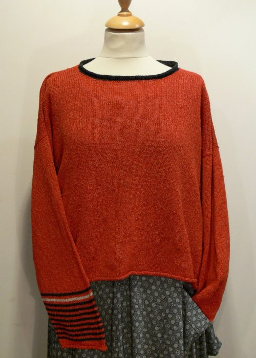Strathy Short Tunic in flame/graphite/shingle. One striped sleeve. Knitted in silk/lambswool. Designed and made in Orkney.Strathy Short Tunic in flame/graphite/shingle. One striped sleeve. Knitted in silk/lambswool. Designed and made in Orkney.