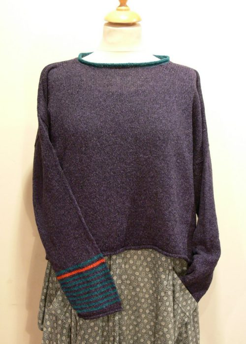 Strathy Short Tunic in gentian/teal/flame. One striped sleeve. Knitted in silk/lambswool. Designed and made in Orkney.