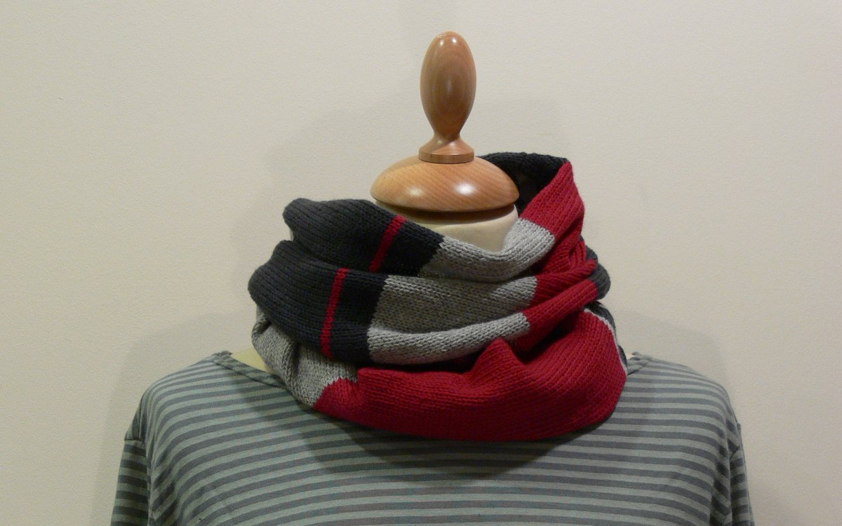 Quernstone loop scarf in cerise, pale grey and black, knitted in 90% superfine wool, 10% cashmere.