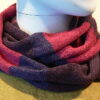 Quernstone loop scarf in plum, cerise and gentian, knitted in 52%silk, 48%lambswool